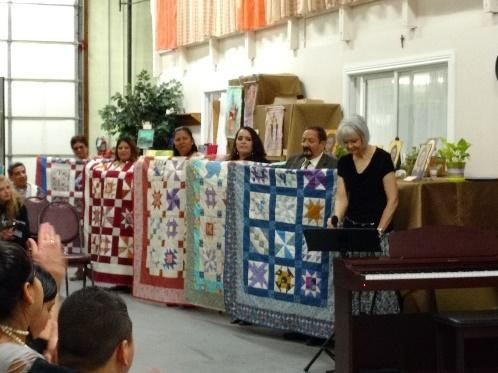 Student's show their off their custom quilts